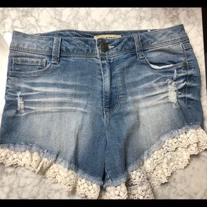 Blue Spice Jean Shorts with lace trim around legs